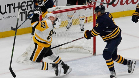Pittsburgh Penguins forward Sidney Crosby (87) reacts after being hit by the stick of Buffalo Sabres Evander Kane (9) during the third period of an NHL hockey game, Tuesday, March 21, 2017, in Buffalo, N.Y. (AP Photo/Jeffrey T. Barnes)