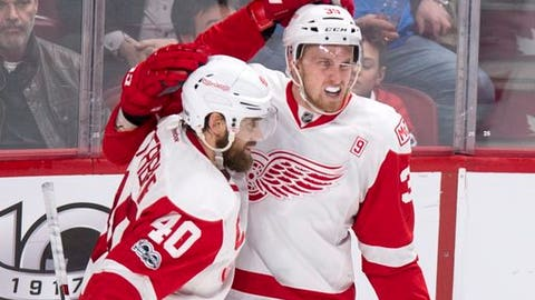 Detroit Red Wings' Anthony Mantha, right, celebrates with teammate Henrik Zetterberg after scoring the winning goal past Montreal Canadiens goalie Al Montoya during overtime in an NHL hockey game in Montreal on Tuesday, March 21, 2017. (Paul Chiasson/The Canadian Press via AP)
