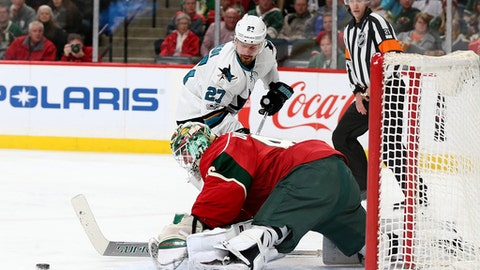 Minnesota Wild's goalie Devan Dubnyk (40) block the shot of San Jose Sharks' Joonas Donskoi (27) in the second period of an NHL hockey game Tuesday, March 21, 2017, in St. Paul, Minn. (AP Photo/Stacy Bengs)
