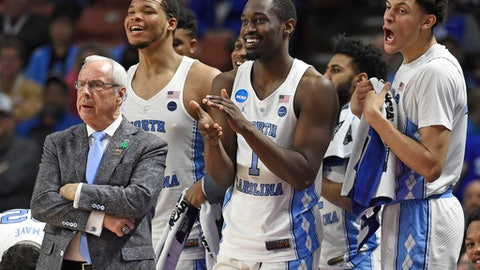 FILE- In this March 17, 2017, file photo, North Carolina head coach Roy Williams, left, and players Kennedy Meeks, Theo Pinson and Justin Jackson react during the second half against Texas Southern in a first-round game of the NCAA men's college basketball tournament in Greenville, S.C. Williams has long emphasized the importance of rebounding and his Tar Heels lead the country in rebounding margin entering the Friday, March 24, game against Butler in the NCAA Tournament's South Region semifinals. (AP Photo/Rainier Ehrhardt, File)