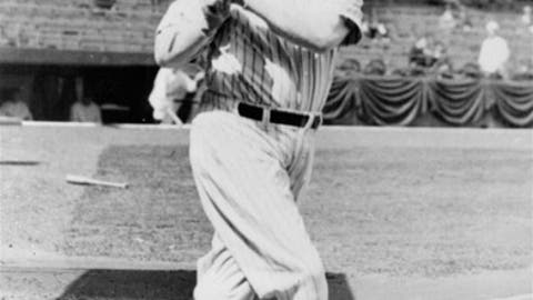 """FILE - In this April 20, 1932, file photo, New York Yankees' Babe Ruth takes a practice cut prior to the Yankees home-opener against the Philadelphia Athletics at Yankee Stadium in New York. Troy Kinunen, president of Memorabilia Evaluation and Research Services, said his company evaluated Babe Ruth's 1932 """"called shot"""" jersey for a private collector. Authenticators used photos of old jerseys Ruth had worn to prove it was the real thing. His company maintains archives of the customizations that certain players' jerseys usually go through. (AP Photo/File)"""