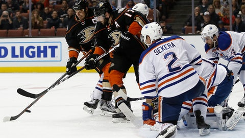 Anaheim Ducks' Ryan Getzlaf, left, and Ryan Kesler (17) vie for the puck with Edmonton Oilers defenseman Andrej Sekera (2), of Slovakia; goalie Laurent Brossoit; and defenseman Kris Russell (4) defending during the second period of an NHL hockey game in Anaheim, Calif., Wednesday, March 22, 2017. (AP Photo/Alex Gallardo)