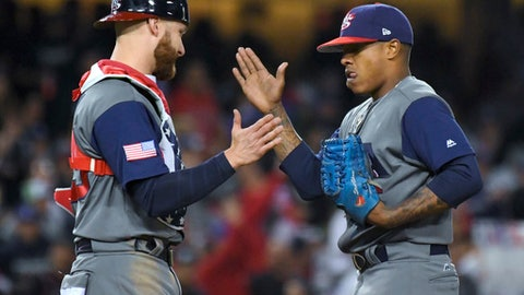 U.S. catcher Jonathan Lucroy, left, greets pitcher Marcus Stroman in the sixth inning against Puerto Rico during the final of the World Baseball Classic. in Los Angeles, Wednesday, March 22, 2017. (AP Photo/Mark J. Terrill)
