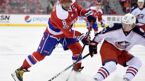 Washington Capitals left wing Alex Ovechkin (8), of Russia, skates with the puck against Columbus Blue Jackets center William Karlsson (25), of Sweden, during the first period of an NHL hockey game, Thursday, March 23, 2017, in Washington. (AP Photo/Nick Wass)