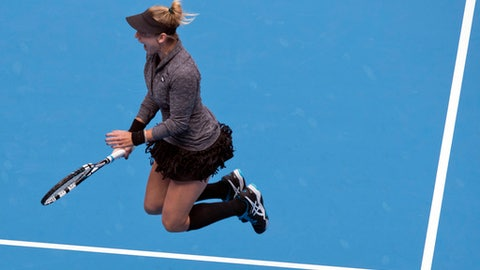 Bethanie Mattek-Sands of the United States jumps after she and her teammate Lucie Safarova of the Czech Republic defeat Caroline Garcia and Kristina Mladenovic of France in the women's doubles final of the China Open tennis tournament at the Diamond Court in Beijing, Sunday, Oct. 9, 2016. (AP Photo/Ng Han Guan)