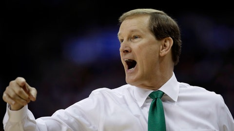Oregon coach Dana Altman shouts to his team during the second half of a regional semifinal against Michigan in the NCAA men's college basketball tournament, Thursday, March 23, 2017, in Kansas City, Mo. (AP Photo/Charlie Riedel)