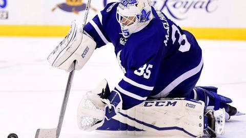 Toronto Maple Leafs goalie Curtis McElhinney (35) stops the puck against the New Jersey Devils during the third period of an NHL hockey game in Toronto on Thursday, March 23, 2017. (Frank Gunn/The Canadian Press via AP)
