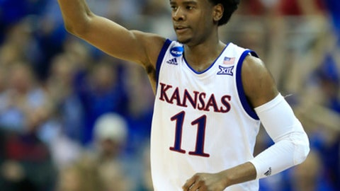 Kansas guard Josh Jackson celebrates after making a 3-point basket during the first half against Purdue in a regional semifinal of the NCAA men's college basketball tournament, Thursday, March 23, 2017, in Kansas City, Mo. (AP Photo/Orlin Wagner)