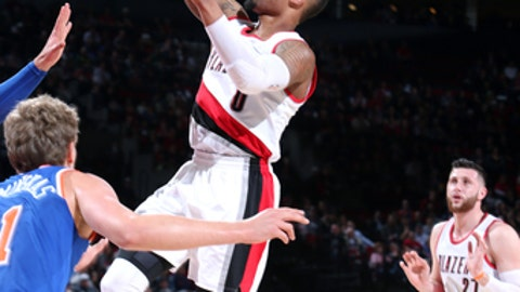 PORTLAND, OR - MARCH 23: Damian Lillard #0 of the Portland Trail Blazers shoots the ball during the game against the New York Knicks on March 23, 2017 at the Moda Center in Portland, Oregon. NOTE TO USER: User expressly acknowledges and agrees that, by downloading and or using this Photograph, user is consenting to the terms and conditions of the Getty Images License Agreement. Mandatory Copyright Notice: Copyright 2017 NBAE (Photo by Sam Forencich/NBAE via Getty Images)