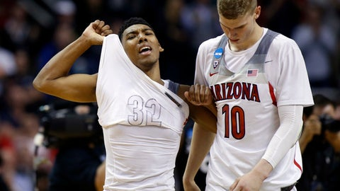 Arizona guard Allonzo Trier, let, and Lauri Markkanen (10) walks off the court after a loss to Xavier during an NCAA Tournament college basketball regional semifinal game Thursday, March 23, 2017, in San Jose, Calif. (AP Photo/Tony Avelar)