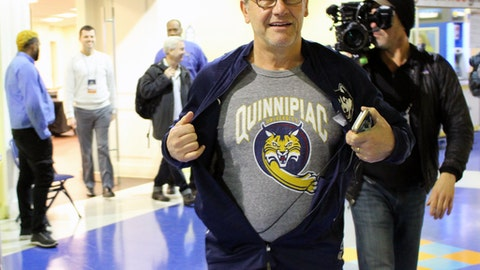 UConn coach Geno Auriemma displays a Quinnipiac University T-shirt before his team's Sweet 16 NCAA women's college basketball practice in Bridgeport, Ct., Friday, March 24, 2017. This is the first year both Connecticut schools have made it as far as the NCAA regional semifinals. (AP Photo/Pat Eaton-Robb)