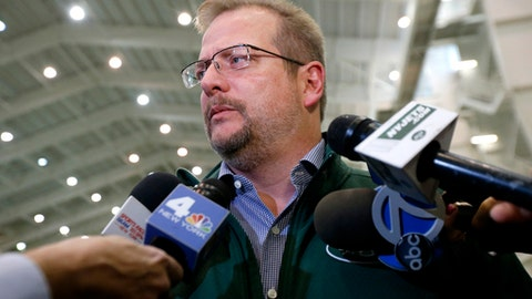 """FILE - In this Jan. 14, 2016, file photo, New York Jets general manager Mike Maccagnan speaks to reporters at the team's NFL football training center in Florham Park, N.J. Maccagnan says it is """"highly unlikely"""" New York will add another veteran quarterback after signing Josh McCown earlier this week. Maccagnan adds during a conference call Friday, March 24, 2017, that any other potential additional quarterback would likely come through the draft.(AP Photo/Julio Cortez, File)"""