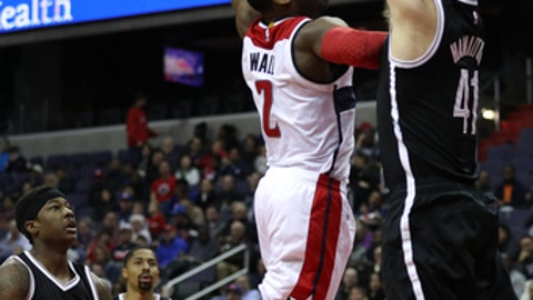 WASHINGTON, DC - MARCH 24: John Wall #2 of the Washington Wizards attempts to dunk on Justin Hamilton #41 of the Brooklyn Nets during the first half at Verizon Center on March 24, 2017 in Washington, DC. NOTE TO USER: User expressly acknowledges and agrees that, by downloading and or using this photograph, User is consenting to the terms and conditions of the Getty Images License Agreement. (Photo by Patrick Smith/Getty Images)