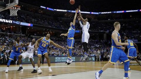 Kentucky guard De'Aaron Fox shoots against UCLA in the first half of an NCAA college basketball tournament South Regional semifinal game Friday, March 24, 2017, in Memphis, Tenn. (AP Photo/Mark Humphrey)