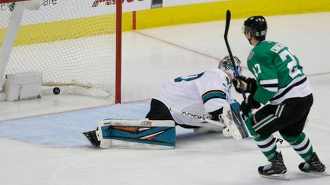 Dallas Stars right wing Adam Cracknell (27) scores a goal against San Jose Sharks goalie Aaron Dell (30) during the third period of an NHL hockey game in Dallas, Friday, March 24, 2017. The Stars won 6-1. (AP Photo/LM Otero)