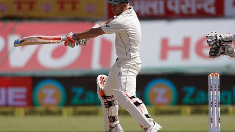 Australia's David Warner plays a shot during the first day of the fourth test cricket match against India in Dharmsala, India, Saturday, March 25, 2017. (AP Photo/Tsering Topgyal)