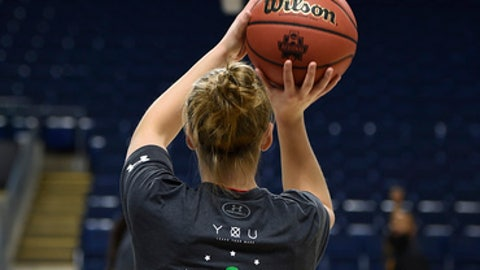 Maryland's Kristen Confroy wears a shirt for Ashlyn Barrett, who suffers from muscular dystrophy in the pregame warm-ups before a regional semifinal game against Oregon in the NCAA women's college basketball tournament, Saturday, March 25, 2017, in Bridgeport, Conn. (AP Photo/Jessica Hill)