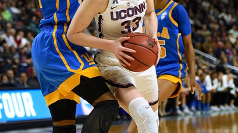 Connecticut's Katie Lou Samuelson drives to the basket as UCLA's Kennedy Burke, left, defends during the second half of a regional semifinal game in the NCAA women's college basketball tournament, Saturday, March 25, 2017, in Bridgeport, Conn. (AP Photo/Jessica Hill)