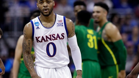 Kansas guard Frank Mason III pauses during the second half of the team's Midwest Regional final against Oregon in the NCAA men's college basketball tournament, Saturday, March 25, 2017, in Kansas City, Mo. Oregon won 74 - 60. (AP Photo/Charlie Riedel)