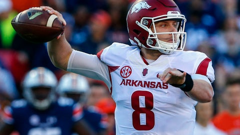 FILE - In this Oct. 22, 2016, file photo, Arkansas quarterback Austin Allen throws a pass against Auburn during the first half of an NCAA college football game,  in Auburn, Ala. The Razorbacks return senior quarterback Austin Allen, but they must improve a defense that allowed 6.75 yards per play last season. (AP Photo/Butch Dill, File)