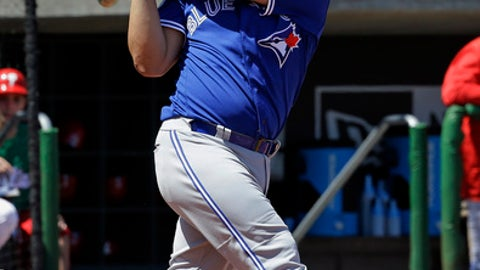 In this Friday, March 17, 2017, photo, Toronto Blue Jays' Kendrys Morales bats against the Philadelphia Phillies in a spring training baseball game, Friday, March 17, 2017, in Clearwater, Fla. Newcomer Morales, who hit 30 home runs for Kansas City last year, expects his slugging totals to increase at hitter-friendly Rogers Centre, much as Josh Donaldson's did in 2015, his first season north of the border, when he was named AL MVP. (AP Photo/John Raoux)
