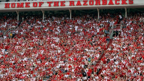 FILE  - In this Sept. 5, 2015, file photo, Arkansas fans cheer on the Hogs during an NCAA college football game against UTEP at Donald W. Reynolds Razorback Stadium in Fayetteville, Ark. The Southeastern Conference said Tuesday, March 28, 2017, it wants Arkansas lawmakers to exempt college sporting events such as football games from a new law greatly expanding where concealed handguns are allowed, citing concerns about safety at its games.  (AP Photo/Samantha Baker, File)