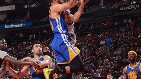 HOUSTON, TX - MARCH 28:Stephen Curry #30 of the Golden State Warriors shoots a lay up against the Houston Rockets on March 28, 2017 at the Toyota Center in Houston, Texas. NOTE TO USER: User expressly acknowledges and agrees that, by downloading and or using this photograph, User is consenting to the terms and conditions of the Getty Images License Agreement. Mandatory Copyright Notice: Copyright 2017 NBAE (Photo by Noah Graham/NBAE via Getty Images)