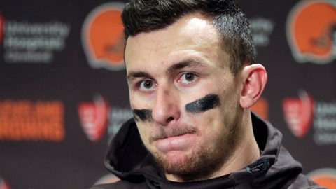 """FILE - In this Dec. 20, 2015, file photo, Cleveland Browns quarterback Johnny Manziel speaks with media members following the team's 30-13 loss to the Seattle Seahawks in an NFL football game in Seattle. New Orleans Saints coach Sean Payton shot down a report that his team had interest in troubled quarterback Johnny Manziel. They did meet during Super Bowl week, but Payton called the report the team was considering adding Manziel """"false."""" (AP Photo/Scott Eklund, File)"""
