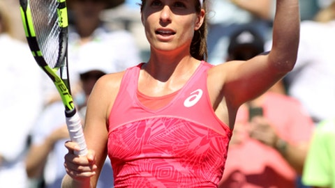Johanna Konta, of Britain, waves after defeating Simona Halep, of Romania, 3-6, 7-6 (7), 6-2 during the Miami Open tennis tournament, Wednesday, March 29, 2017, in Key Biscayne, Fla. (AP Photo/Luis M. Alvarez)