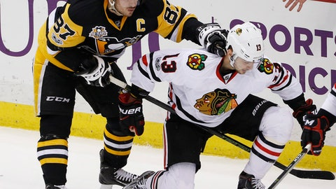 Pittsburgh Penguins' Sidney Crosby (87) shoves Chicago Blackhawks' Tomas Jurco (13) in the first period of an NHL hockey game in Pittsburgh, Wednesday, March 29, 2017. (AP Photo/Gene J. Puskar)