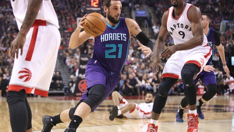 TORONTO, ON - MARCH 29: Marco Belinelli #21 of the Charlotte Hornets drives to the basket past Serge Ibaka #9 of the Toronto Raptors during NBA game action at Air Canada Centre on March 29, 2017 in Toronto, Canada. NOTE TO USER: User expressly acknowledges and agrees that, by downloading and or using this photograph, User is consenting to the terms and conditions of the Getty Images License Agreement. (Photo by Tom Szczerbowski/Getty Images)