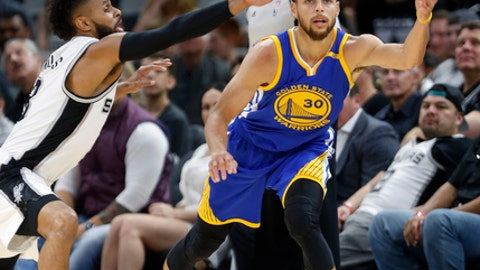 SAN ANTONIO,TX - MARCH 29:  Patty Mills #8 of the San Antonio Spurs tries to steal the ball from Stephen Curry #30 of the Golden State Warriors at AT&T Center on March 29, 2017 in San Antonio, Texas.  NOTE TO USER: User expressly acknowledges and agrees that , by downloading and or using this photograph, User is consenting to the terms and conditions of the Getty Images License Agreement. (Photo by Ronald Cortes/Getty Images)