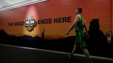Oregon's Charlie Noebel walks to the locker room after a practice session for their NCAA Final Four tournament college basketball semifinal game Thursday, March 30, 2017, in Glendale, Ariz. (AP Photo/David J. Phillip)
