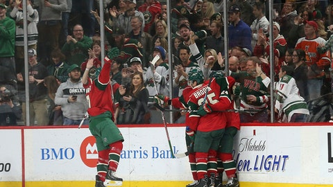 Minnesota Wild's Chris Stewart, left, skates up to eamtmates to celebrate a goal against the Ottawa Senators in the second period of an NHL hockey game Thursday, March 30, 2017, in St. Paul, Minn. (AP Photo/Stacy Bengs)
