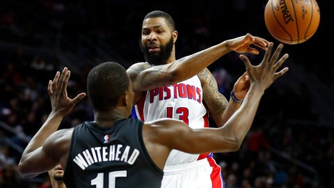 AUBURN HILLS, MI - MARCH 30: Marcus Morris #13 of the Detroit Pistons passes to a teammate around Isaiah Whitehead #15 of the Brooklyn Nets during the first half at the Palace of Auburn Hills on March 30, 2017 in Auburn Hills, Michigan. NOTE TO USER: User expressly acknowledges and agrees that, by downloading and or using this photograph, User is consenting to the terms and conditions of the Getty Images License Agreement.  (Photo by Gregory Shamus/Getty Images)