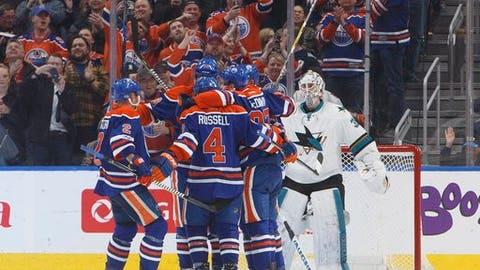 The Edmonton Oilers celebrate a goal against San Jose Sharks goalie Martin Jones, right, during the third period of an NHL hockey game Thursday, March 30, 2017, in Edmonton, Alberta. (Jason Franson/The Canadian Press via AP)