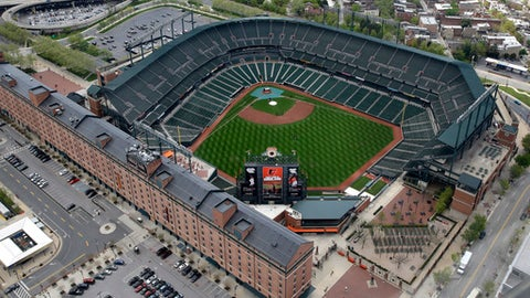 Oriole Park at Camden Yards sits empty, Tuesday, April 28, 2015, in Baltimore. It's been 25 years since the Baltimore Orioles began playing in Camden Yards, the start of a nationwide trend of major league teams moving into new ballparks. (AP Photo/Patrick Semansky)