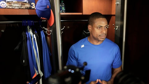 New York Mets right fielder Curtis Granderson talks with members of the media in the clubhouse at CitiField, Friday, March 31, 2017, in New York. The Mets open the season at home on Monday, April 3, against the Atlanta Braves. (AP Photo/Julie Jacobson)