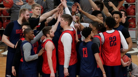 Gonzaga players huddle during a practice session for their NCAA Final Four tournament college basketball semifinal game Friday, March 31, 2017, in Glendale, Ariz. (AP Photo/Matt York)