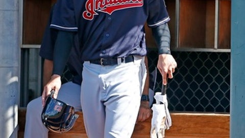 FILE- In this Feb. 20, 2017, file photo, Cleveland Indians' Michael Brantley gets ready to bat at the team's baseball spring training facility in Goodyear, Ariz. Brantley has likely made Cleveland's opening-day roster and could be in left field for the opener in Texas on Monday. Brantley has worked his way back after playing in just 11 games last season following right shoulder surgery. Manager Terry Francona said Brantley has not suffered any setbacks after playing in three straight games this week. (AP Photo/Ross D. Franklin, File)