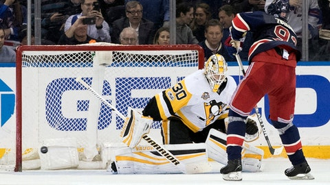Pittsburgh Penguins goalie Matt Murray (30) stops New York Rangers center Mika Zibanejad (93) from scoring during the shootout in an NHL hockey game, Friday, March 31, 2017, at Madison Square Garden in New York. The penguins won 4-3. (AP Photo/Mary Altaffer)