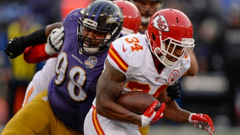 Dec 20, 2015; Baltimore, MD, USA; Kansas City Chiefs running back Knile Davis (34) runs through Baltimore Ravens nose tackle Brandon Williams (98) tackle attempt at M&T Bank Stadium. Kansas City defeated Baltimore 34-14. Mandatory Credit: Tommy Gilligan-USA TODAY Sports