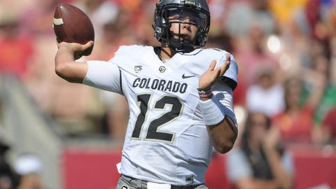 Oct 8, 2016; Los Angeles, CA, USA; Colorado Buffaloes quarterback Steven Montez (12) throws a pass against the USC Trojans during a NCAA football game at Los Angeles Memorial Coliseum. Mandatory Credit: Kirby Lee-USA TODAY Sports