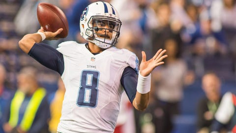 Nov 20, 2016; Indianapolis, IN, USA; Tennessee Titans quarterback Marcus Mariota (8) passes the ball in the first quarter the game against the Indianapolis Colts at Lucas Oil Stadium. Mandatory Credit: Trevor Ruszkowski-USA TODAY Sports