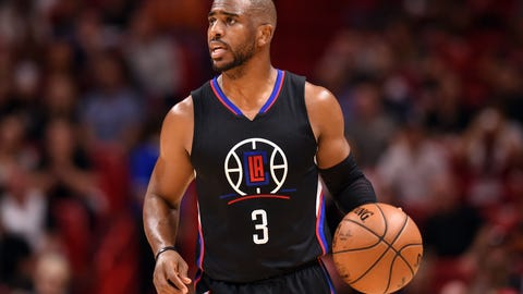 Dec 16, 2016; Miami, FL, USA; LA Clippers guard Chris Paul (3) dribbles the ball up court during the first half against the Miami Heat at American Airlines Arena. Mandatory Credit: Steve Mitchell-USA TODAY Sports