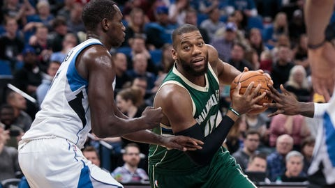 Dec 30, 2016; Minneapolis, MN, USA; Milwaukee Bucks center Greg Monroe (15) drives in the first quarter against the Minnesota Timberwolves center Gorgui Dieng (5) at Target Center. Mandatory Credit: Brad Rempel-USA TODAY Sports