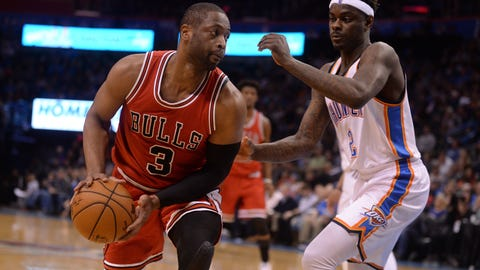 Feb 1, 2017; Oklahoma City, OK, USA; Chicago Bulls guard Dwyane Wade (3) drives to the basket in front of Oklahoma City Thunder guard Anthony Morrow (2) during the fourth quarter at Chesapeake Energy Arena. Mandatory Credit: Mark D. Smith-USA TODAY Sports