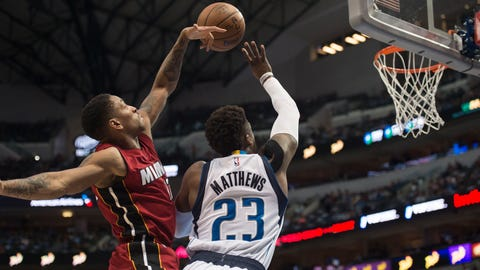 Feb 27, 2017; Dallas, TX, USA; Miami Heat guard Rodney McGruder (17) blocks a shot by Dallas Mavericks guard Wesley Matthews (23) during the first quarter at the American Airlines Center. Mandatory Credit: Jerome Miron-USA TODAY Sports