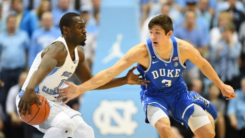 Mar 4, 2017; Chapel Hill, NC, USA; North Carolina Tar Heels forward Theo Pinson (1) with the ball as Duke Blue Devils guard Grayson Allen (3) defends in the first half at Dean E. Smith Center. Mandatory Credit: Bob Donnan-USA TODAY Sports