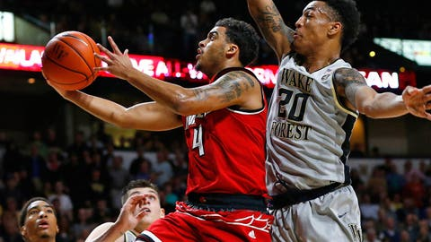 Mar 1, 2017; Winston-Salem, NC, USA; Louisville Cardinals guard Quentin Snider (4) goes up for a shot against Wake Forest Demon Deacons forward John Collins (20) in the second half at Lawrence Joel Veterans Memorial Coliseum. Wake defeated Louisville 88-81. Mandatory Credit: Jeremy Brevard-USA TODAY Sports